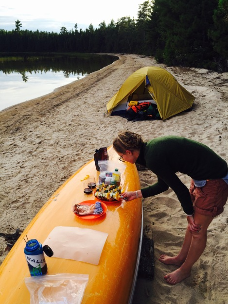 an overturned canoe makes an excellent kitchen counter